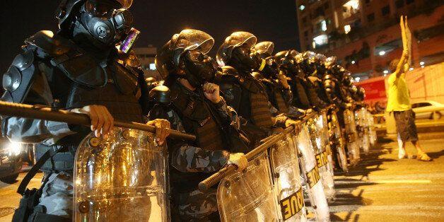 RIO DE JANEIRO, BRAZIL - JUNE 15:  Military Police block anti-World Cup protestors attempting to march to Maracana stadium on