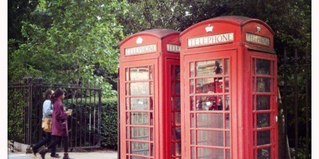 Old fashioned British telephone boxes at the entrance to Russell Square, London,