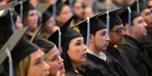 IMAGE DISTRIBUTED FOR PEARSON - The 2015 graduating class of Texas Southmost College listens as John...
