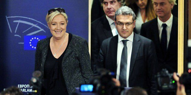 French far-right National Front (FN) party president Marine Le Pen (L), FN newly elected member of European parliament Aymeri
