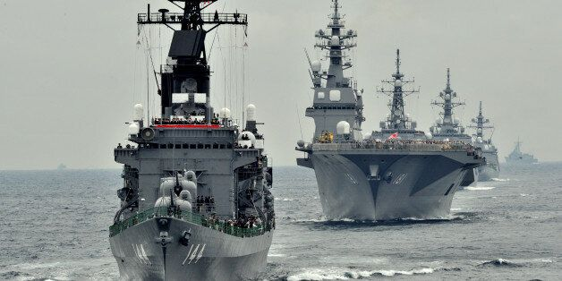 Japan Maritime Self-Defence Force escort ship Kurama (L) sails during their 2012 navy fleet review off Sagami Bay, Japan's Ka