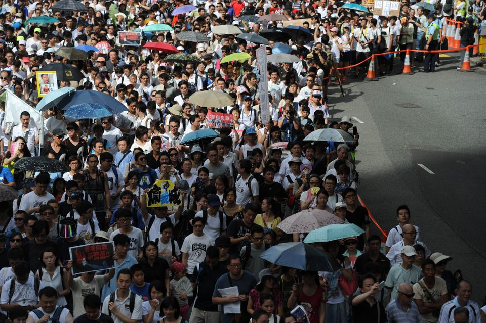 Protesters march during a pro-democracy rally seeking greater democracy in Hong Kong on July 1, 2014 as frustration grows ove