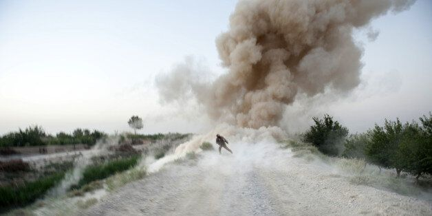 US Marine Sergeant Anthony Zabala of 1st Combat Engineering Battalion of 2nd Marine Expeditionary Brigade runs to safety as a