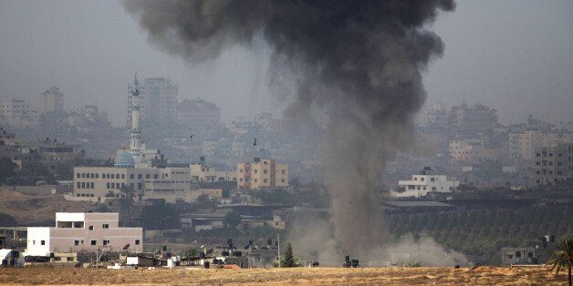 A picture taken from the southern Israeli border with the Gaza Strip shows smoke billowing following Israeli air strikes insi