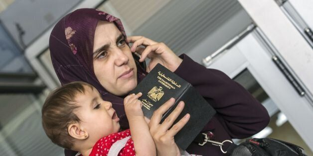 A Resident from the Gaza strip, holding dual citizenship, waits for clearance at Erez crossing in Beit Hanun in the north of