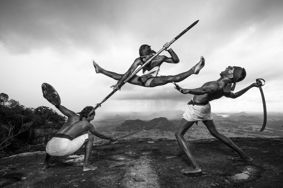 "Demonstrating the fighting style of Illangam (fighting with weapons) using traditional Angampora weapons. © <a href=""https://"