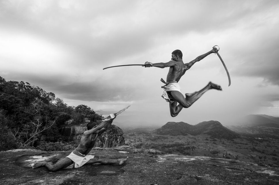 "Fighters demonstrating Illangam, a fighting style using traditional Angampora weapons. © <a href=""https://www.behance.net/gal"
