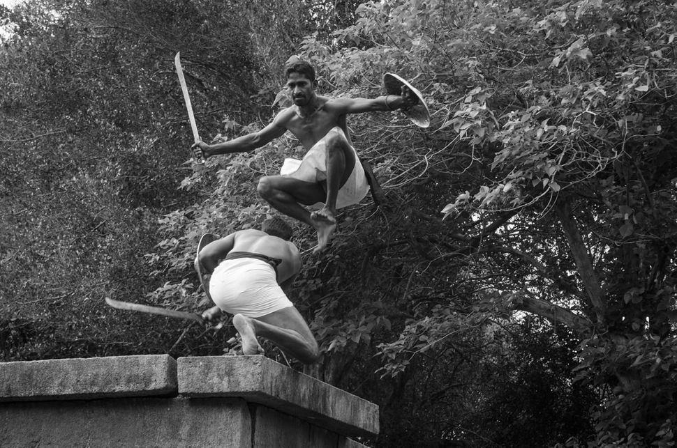"Angampora fighters demonstrating Kadu Pali Satan, a traditional fighting style using swords and shields. ©  <a href=""https://"