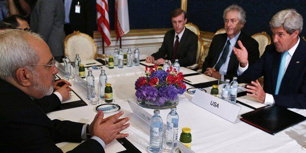 Iran's Foreign Minister Mohammad Javad Zarif (L) meets with US Secretary of State John Kerry (R) during talks between the for