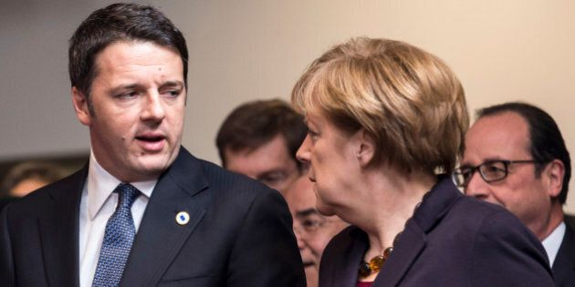 German Chancellor Angela Merkel, second right, speaks with Italian Prime Minister Matteo Renzi, left,...