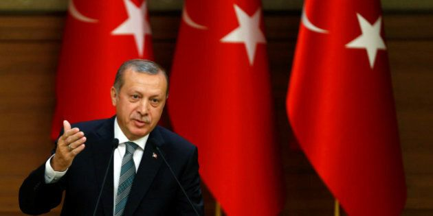 Turkish President Tayyip Erdogan makes a speech during his meeting with mukhtars at the Presidential...