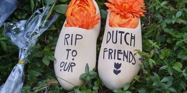 A pair of clogs with a message for Dutch citizens killed on the Malaysia Airlines flight MH17 is seen in front of the Netherl