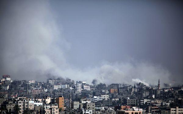 Smoke rises after an Israeli shell hit at Shijaiyah neighborhood, Gaza City, Monday, July 21, 2014.