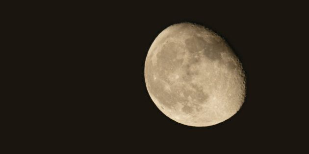 Local at 22:26:03 on Aug 3, 2015,Southern china's,A bright gibbous moon rising in night sky.Shot with...
