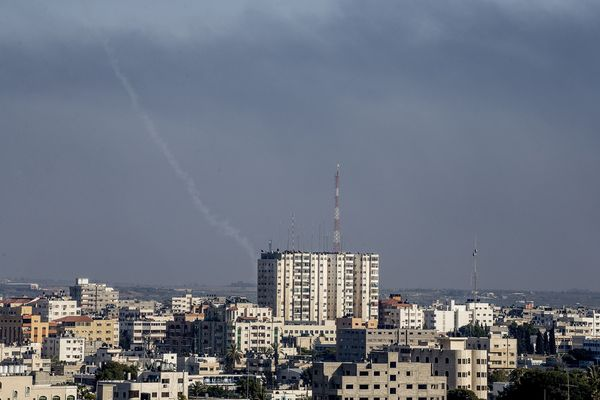 The trail of a Palestinian rocket launched by Palestinian militants into Israel is seen from an area East of Gaza City, on Ju