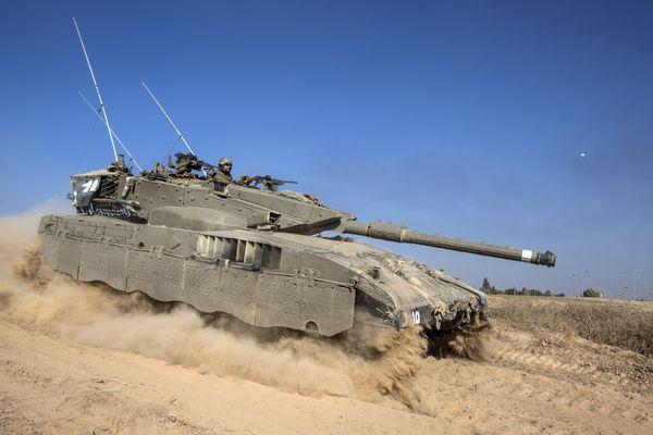 An Israeli Merkava tank rolls near the Israeli-Gaza Strip border, on July 21, 2014.