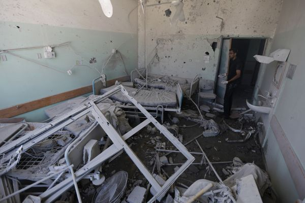 A Palestinian employee inspects damages at the Al-Aqsa Martyrs hospital in Deir al-Balah, in the central Gaza Strip, after th