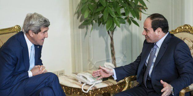 Egypts President Abdel Fattah al-Sisi (R) and US Secretary of State John Kerry talk before a meeting at the Presidential Pala