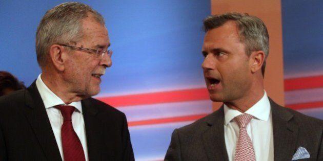 Alexander Van der Bellen, candidate of the Austrian Greens talks with Norbert Hofer, right, of Austria's...