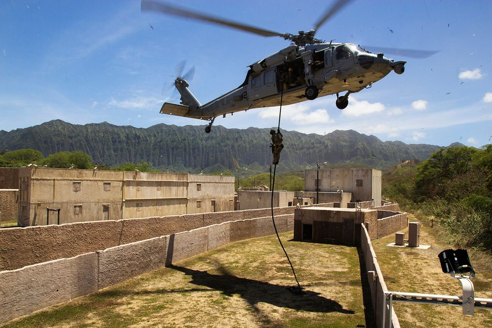 Korean SEALS fast-rope into a RIMPAC training village on July 10 Marine Corps Training Area Bellows in Kaneohe Bay, Hawaii. T