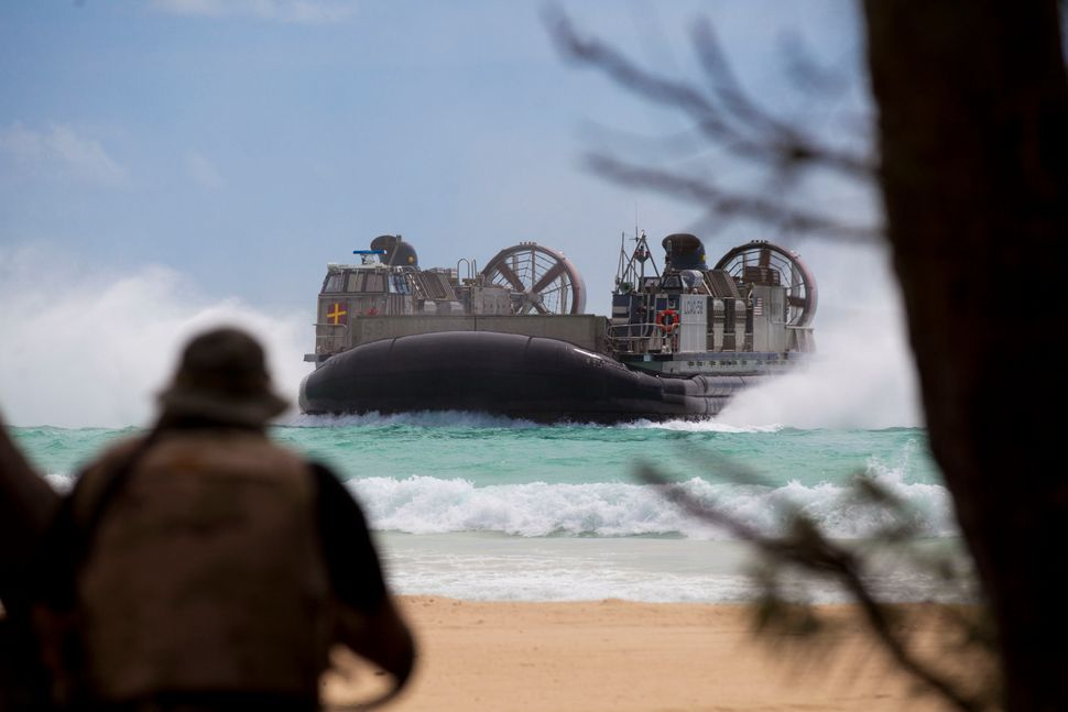 A Landing Craft Air Cushion (LCAC), embarked from the USS Rushmore, prepares to land at Marine Corps Base Hawaii in Kaneohe B