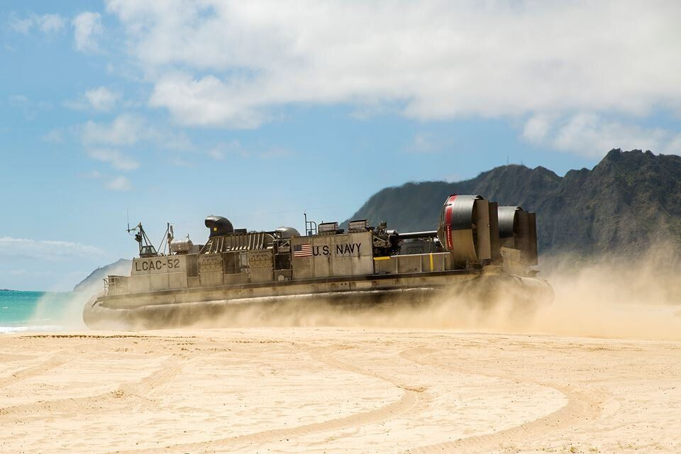A U.S. Navy Landing Craft Air Cushion (LCAC) leaves the Marine Corps Training Area Bellows in Kaneohe Bay, Hawaii, and heads