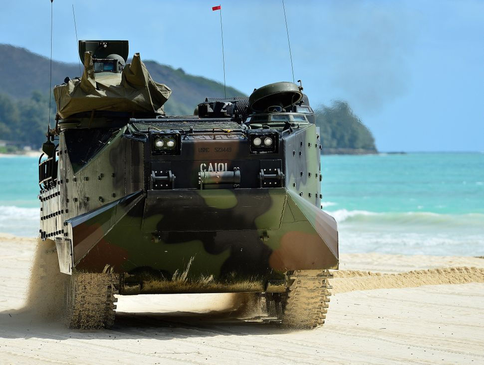 A Marine assault amphibious vehicle assigned to Combat Assault Company, 3rd Marine Regiment arrives on the beach July 11 at B