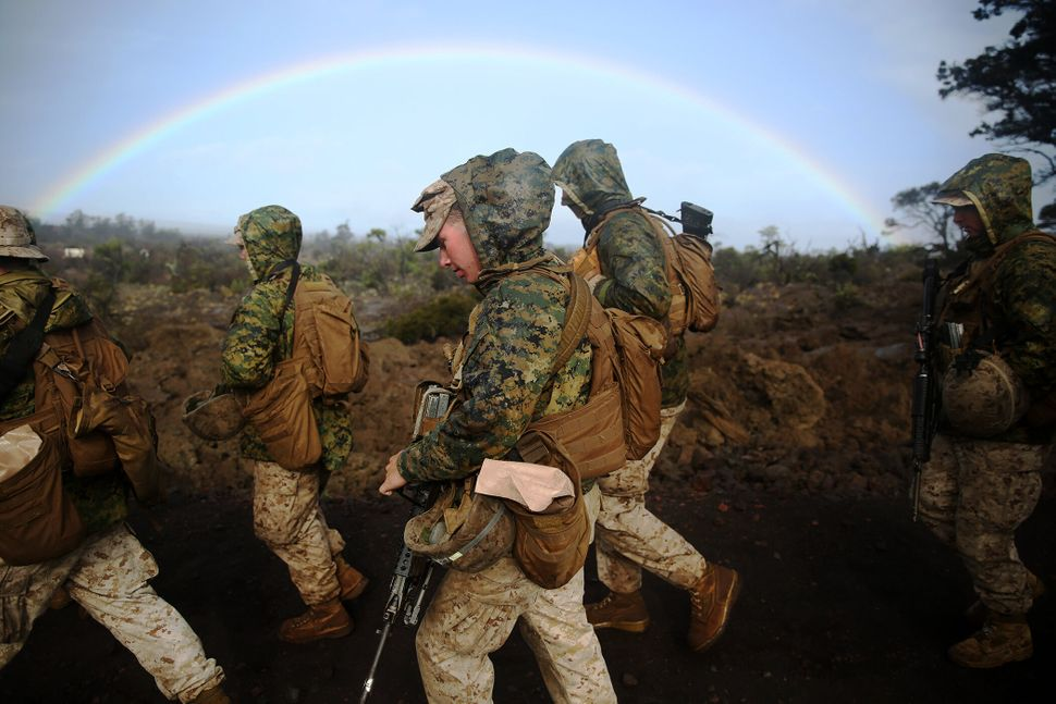 Marines with Headquarters Battery, 1st Battalion, 12th Marine Regiment, walk to Range 5C to conduct a grenade range exercise