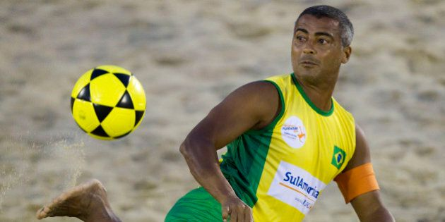 Brazil's former soccer star Romario controls the ball during a Footvolley World Championship match with...