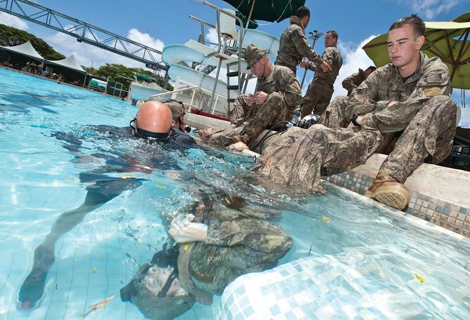 A light infantry platoon from 1st Battalion Royal New Zealand Infantry Regiment (1RNZIR) practice underwater helicopter escap