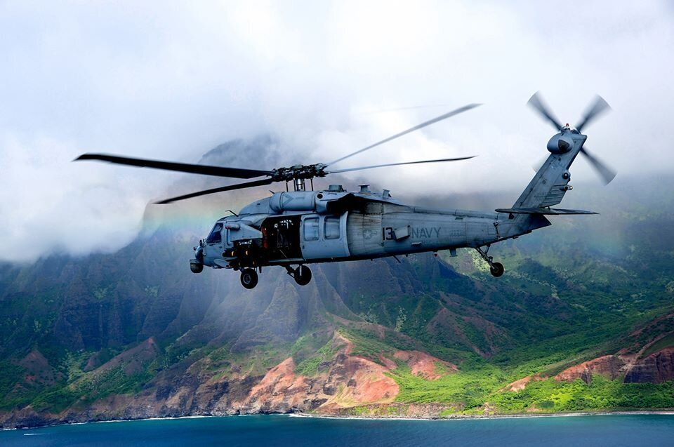An MH-60S Seahawk helicopter assigned to the Black Knights of Helicopter Sea Combat Squadron (HSC) 4, embarked aboard the air