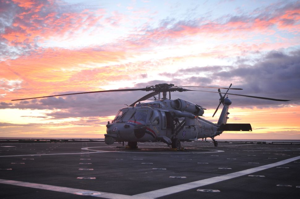 """A U.S. Navy MH-60S Seahawk helicopter assigned to the """"Indians"""" of Helicopter Sea Combat Squadron (HSC) 6 prepares for takeof"""