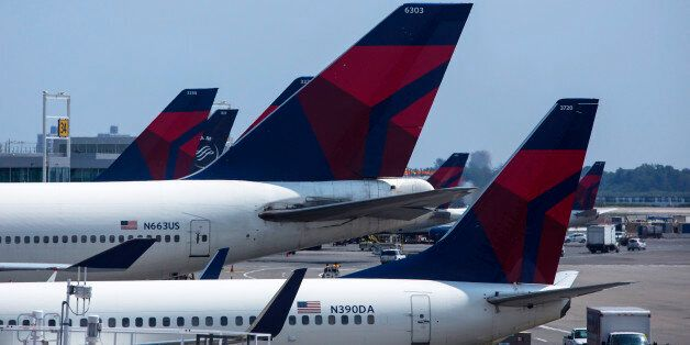 NEW YORK - JULY 22:  Delta Airlines planes sit at Terminal 4 at John F. Kennedy Airport July 22, 2014 in New York City. The F