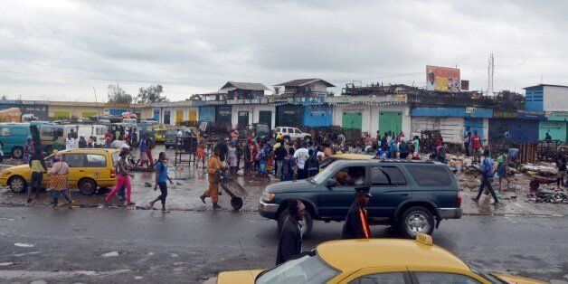 People walk at the closed Red Light market in Monrovia where offices and shops were closed as part of a disinfection campaign