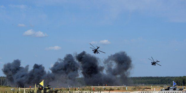 Russia's helicopters perform before the start of a tank biathlon, a paramilitary international competition with armour races