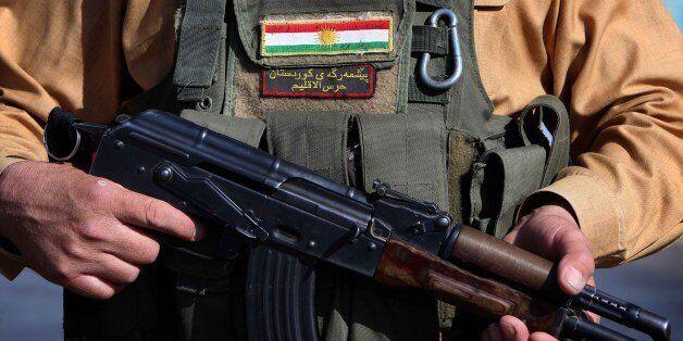 Iraqi Kurdish Peshmerga fighters take position on the front line in Khazer, near the Kurdish checkpoint of Aski kalak, 40 km