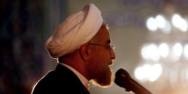 Iranian President Hassan Rouhani delivers a speech on the eve of the 25th anniversary of the Islamic revolutionary leader Aya