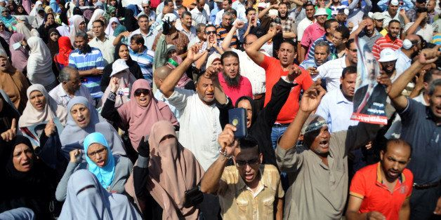 Supporters of the Muslim Brotherhood and Egypt's ousted president Mohamed Morsi chant slogans as they demonstrate in Egypt's