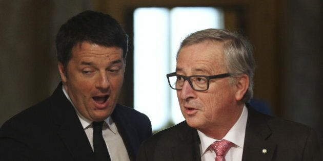 Italy's Prime Minister Matteo Renzi (L) welcomes European Commission President Jean-Claude Juncker at...