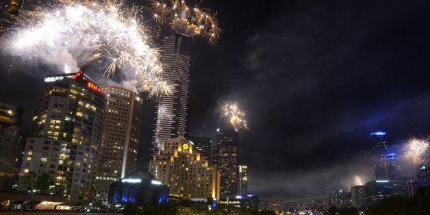 MELBOURNE, AUSTRALIA - DECEMBER 31:  Fireworks over Melbourne skyline and Yarra River during New Years Eve fireworks on Decem