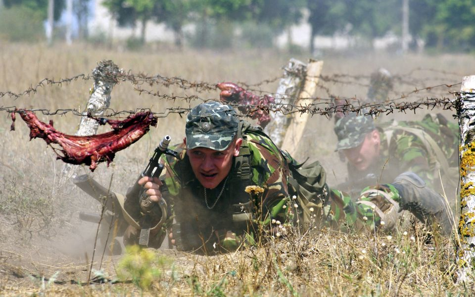Cadets of a Ukrainian military academy crawl under barbed wire as part of exercises near the southern Ukrainian city of Odess