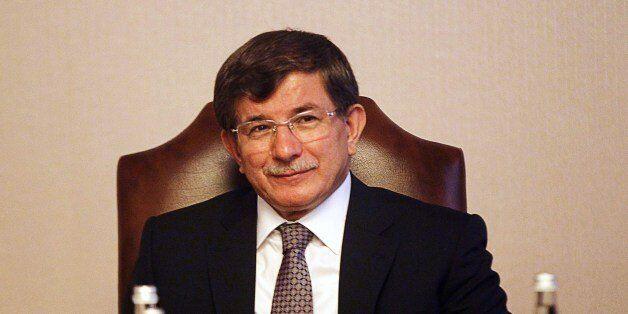 Turkey's Foreign Minister Ahmet Davutoglu attends a meeting in Ankara on August 20, 2014. Turkish President Abdullah Gul said