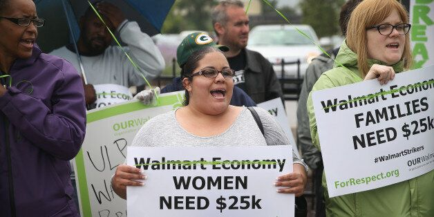 CHICAGO, IL - JUNE 04:  Wal-Mart workers and union activists protest outside a Wal-Mart store on June 4, 2014 in Chicago, Ill