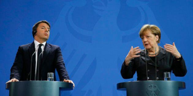 German Chancellor Angela Merkel and Italian Prime Minister Matteo Renzi address a news conference at...