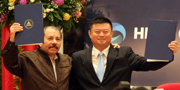 Nicaraguan President Daniel Ortega (L) stands with Wang Jing, president of of the Chinese company HK Nicaragua Development Gr