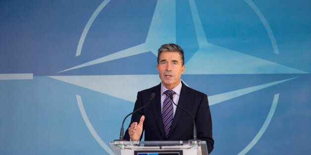 NATO Secretary General Anders Fogh Rasmussen speaks during a media conference at NATO headquarters in Brussels on Friday, Aug