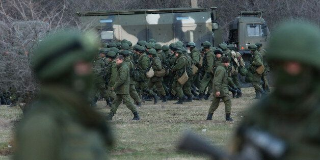 PEREVALNE, UKRAINE - MARCH 05:  Troops under Russian command assemble before getting into trucks near the Ukrainian military