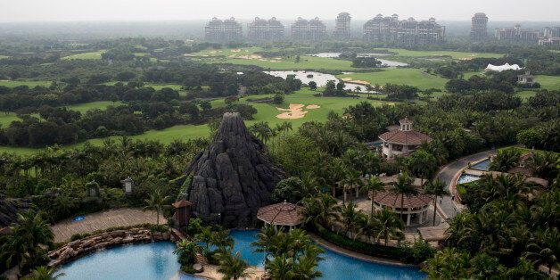 A swimming pool sits near the golf course and residential properties at Mission Hills Resort Haikou in Haikou, Hainan Provinc
