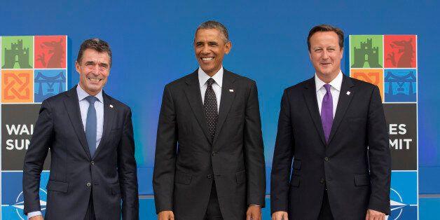 U.S. President Barack Obama, center, stands with NATO Secretary General Anders Fogh Rasmussen, left, and British Prime Minist
