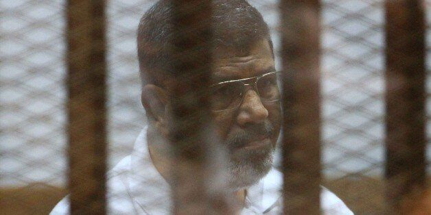 Egypt's deposed Islamist president Mohamed Morsi, charged along with 130 others of plotting attacks and escaping from prison